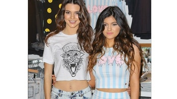 The two Jenner girls, Kendall and Kylie Jenner , are working hard this afternoon.  They are at the Glendale Galleria promoting their new clothing line with PacSun. Saturday, November 9, 2013. X17online.com