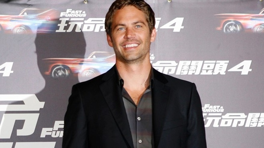 U.S. actor Paul Walker poses for photographers during a news conference in Taipei April 14, 2009.