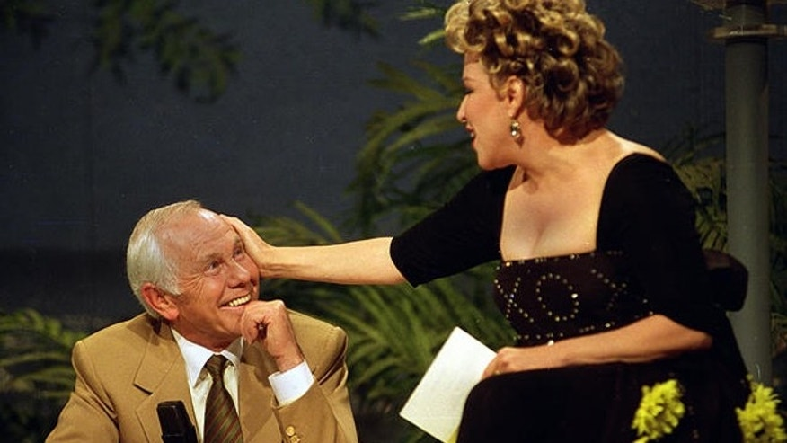 """Entertainer Bette Midler caresses talk show host Johnny Carson during his next-to-last taping of """"The Tonight Show"""" in Burbank, Ca., Thursday, May 21, 1992."""