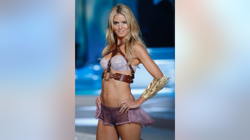 November 15, 2008. Victoria's Secret model Heidi Klum walks the runway at the Victoria's Secret Fashion Show 2008 in Miami Beach, Florida.