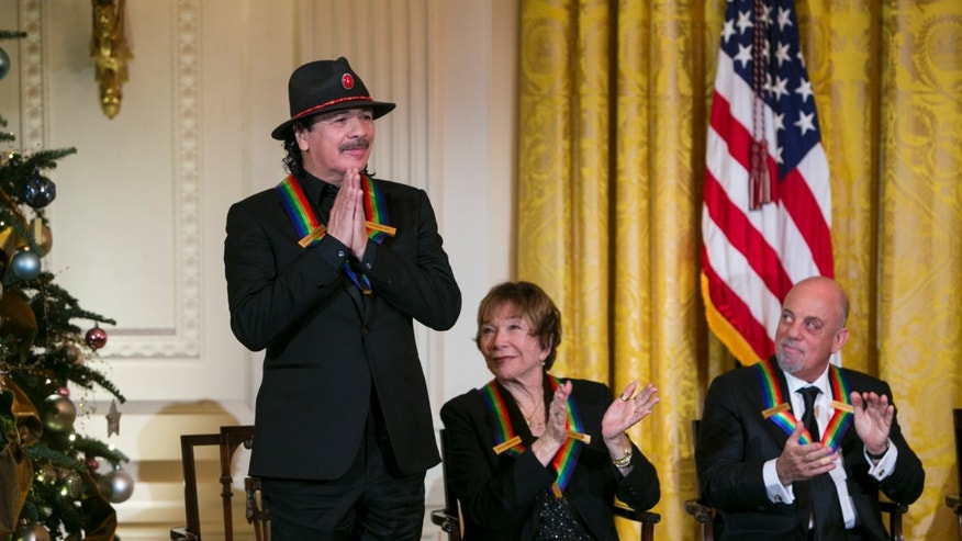 Kennedy Center Honorees Carlos Santana, Shirley MacLaine and Billy Joel on December 8, 2013 in Washington, DC.