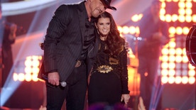 Trace Adkins, left, and Danica Patrick speak on stage at the American Country Awards at the Mandalay Bay Resort & Casino on Tuesday, Dec. 10, 2013, in Las Vegas. (Photo by Frank Micelotta/Invision/AP)