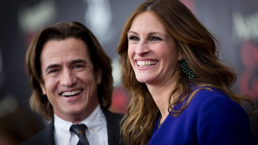 "December 12, 2013. Cast members Dermot Mulroney and Julia Roberts arrive for the premiere of the movie  ""August: Osage County"" in New York."