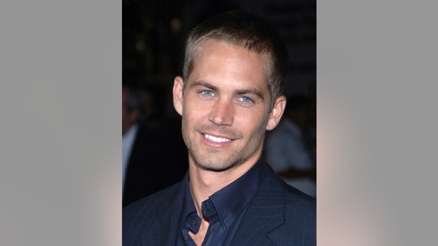 "September 21, 2005. Actor Paul Walker arrives for the premiere of  ""Into the Blue"" at the Mann Village in the Westwood area of Los Angeles."