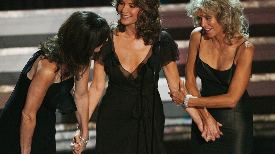 "Former ""Charlie's Angels"" stars Kate Jackson,  Jaclyn Smith and Farrah Fawcett stand onstage during a tribute to Aaron Spelling at the 58th annual Primetime Emmy Awards at the Shrine Auditorium in Los Angeles August 27, 2006."