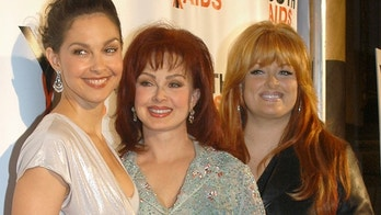 Entertainers Ashley Judd (L), her mother Naomi Judd and sister Wynonna