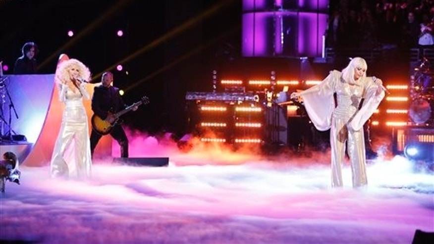 Christina Aguilera and Lady Gaga perform during the season finale of The Voice, on Dec. 17, 2013.