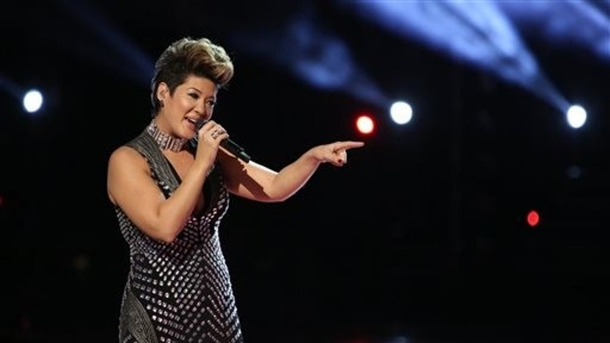 Tessanne Chin sings during the season finale of The Voice on Dec. 17, 2013.