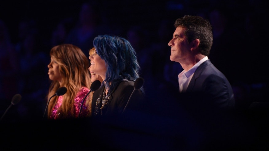 Kelly Rowland, Paulina Rubio, Demi Lovato and Simon Cowell on THE X FACTOR airing Thursday Nov. 21, 2013.