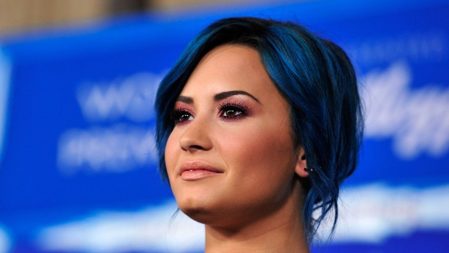 HOLLYWOOD, CA - NOVEMBER 19:  Actress Demi Lovato attends the premiere of Walt Disney Animation Studios' 'Frozen'at the El Capitan Theatre on November 19, 2013 in Hollywood, California.  (Photo by Frazer Harrison/Getty Images)