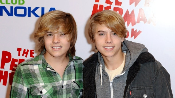 "Actors Cole Sprouse and Dylan Sprouse (L) arrive at the opening night of the ""Pee Wee Herman Show"" in Los Angeles, California January 20, 2010. REUTERS/Gus Ruelas (UNITED STATES - Tags: ENTERTAINMENT) - RTR298QG"
