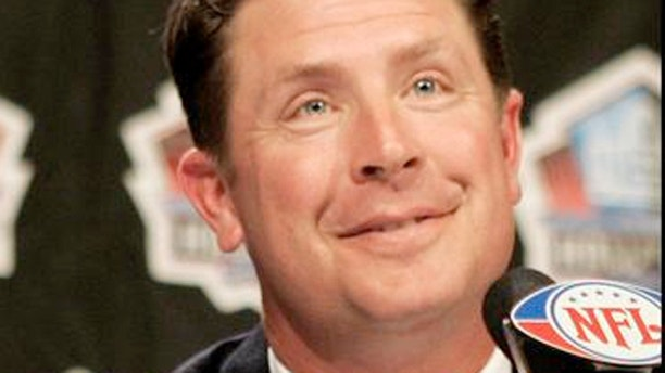 Former Miami Dolphins quarterback Dan Marino gives the thumbs up after being elected into the NFL Pro Football Hall of Fame.