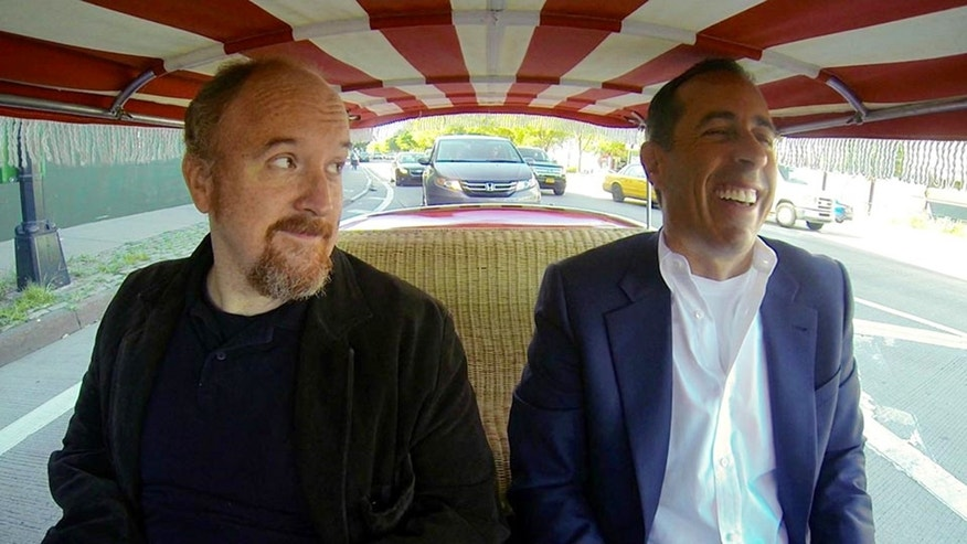 "This image released by Crackle shows comedians Louis C.K., left, and Jerry Seinfeld in a scene from Seinfeld's new web series talk show ""Comedians in Cars Getting Coffee."" The series launched on the Crackle digital network in 2012, and its third season cranks up Thursday, Jan. 2, with Seinfeld joining Louis C.K. for a cup of joe after a zany ride on a clown-car-scale 1959 Fiat Jolly. (AP Photo/Crackle)"