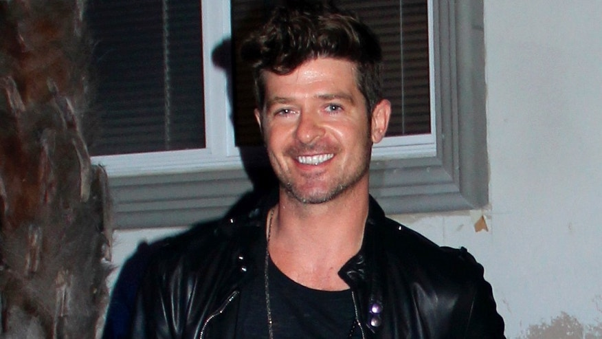 Robin Thicke in major car crash in front of Chateau Marmont : before and after July 10, 2012 X17online.com
