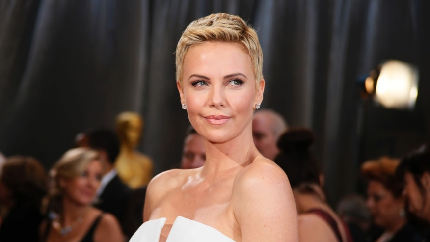 February 24, 2013. Charlize Theron wearing white Dior Haute Couture column gown at the 85th Academy Awards in Hollywood, California.