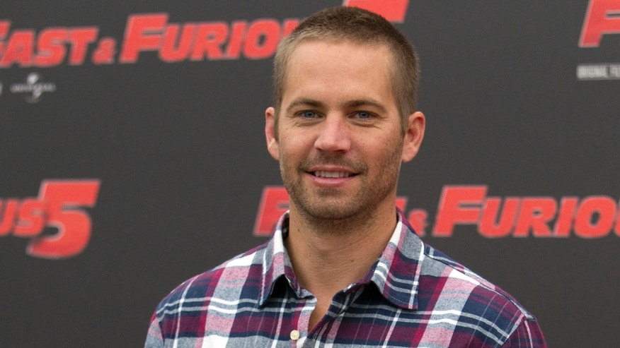 "Paul Walker poses during the photo call of ""Fast and Furious"" in Rome, on April 29, 2011."