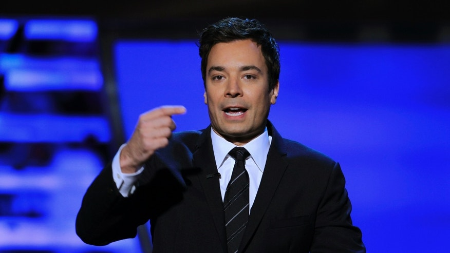 February 4, 2012. Jimmy Fallon presents the Never Say Never award at the Inaugural National Football League Honors at Super Bowl XLVI in Indianapolis, Indiana.