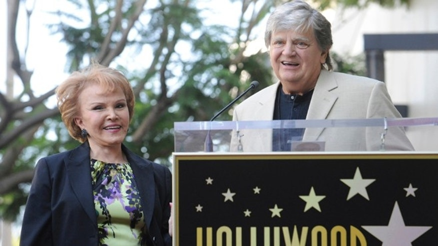 Sept. 7, 2011: Late musician Buddy Holly's wife Maria Elena Holly, left, looks on as musician Phil Everly speaks during a ceremony posthumously awarding Buddy Holly with a star on the Hollywood Walk of Fame in Hollywood.
