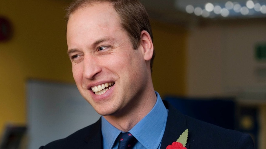 November 6, 2013. Prince William smiles during a visit to the head office of the St Giles Trust, in Camberwell, south east London.