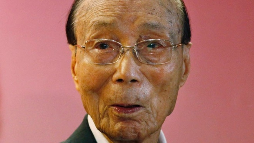 Sept, 28, 2010: Run Run Shaw poses for a photograph during the Run Run Shaw prize presentation ceremony in Hong Kong.