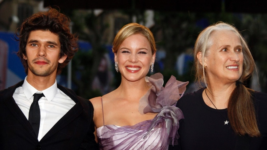"Director Jane Campion (R) with cast members Abbie Cornish (C) and Ben Wishaw (L) arrive for the screening of their film ""Bright Star"" at the 62nd Cannes Film Festival May 15, 2009. Twenty films compete for the prestigious Palme d'Or which will be awarded on May 24.   REUTERS/Jean-Paul Pelissier (FRANCE ENTERTAINMENT) - RTXHC2D"
