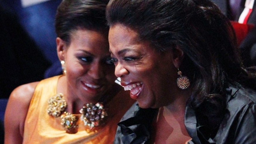 U.S. first lady Michelle Obama speaks with television talk show host Oprah Winfrey at the opening ceremonies of the the 121st International Olympic Committee (IOC) Session and XIII Olympic Congress at the Copenhagen Opera House October 1, 2009.