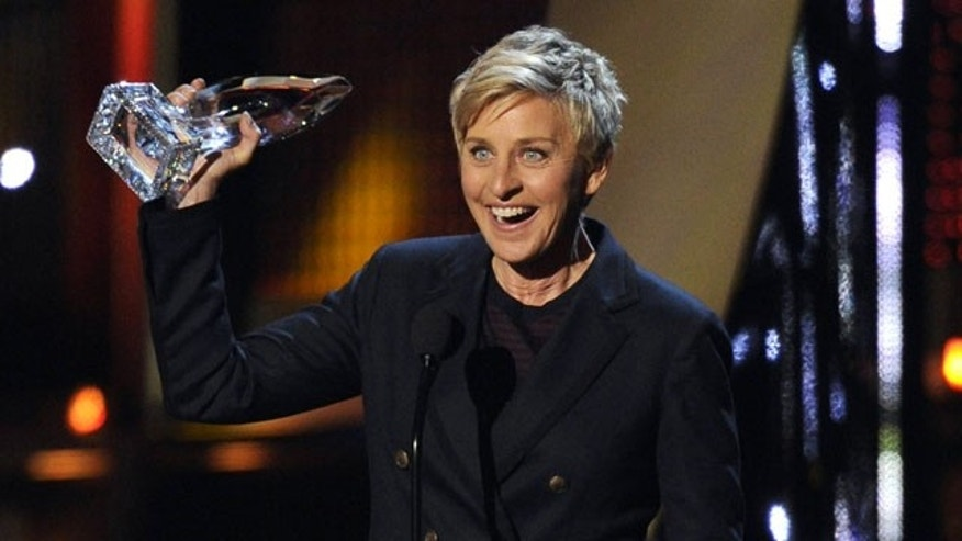 January 8, 2014: Ellen DeGeneres accepts the award for favorite daytime TV host at the 40th annual People's Choice Awards at the Nokia Theatre in Los Angeles. (Photo by Chris Pizzello/Invision/AP)