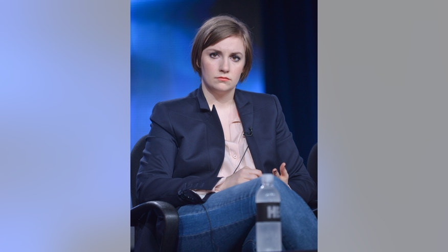 Lena Dunham on stage during the Girls panel discussion at the HBO portion of the 2014 Winter Television Critics Association tour at the Langham Hotel on Thursday, Jan. 9, 2014 in Pasadena, Calif. (Photo by Richard Shotwell Invision/AP)