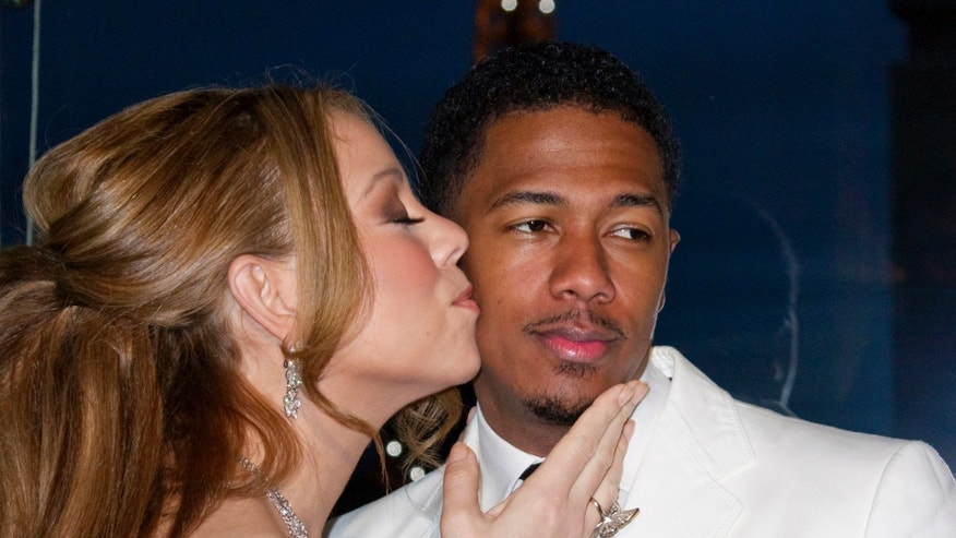 April 27, 2012. Mariah Carey and husband Nick Cannon attend a photo call near the Eiffel Tower before their vow renewal ceremony in Paris.