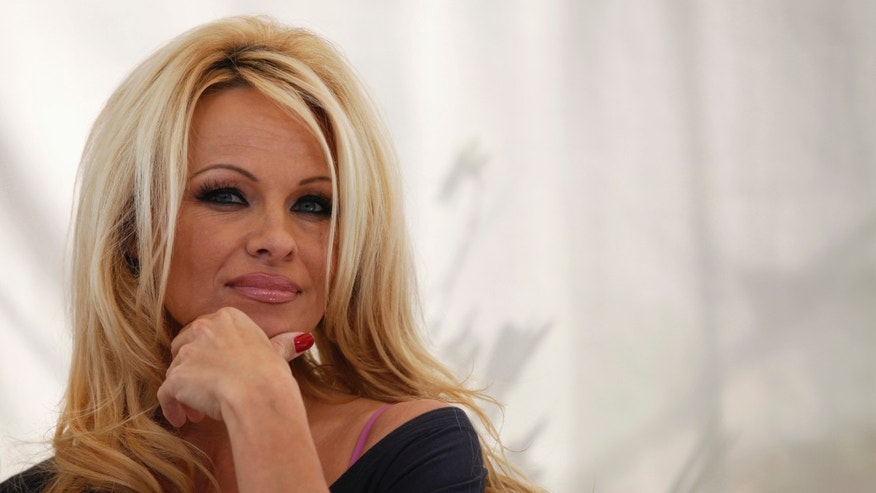 March 22, 2012. Pamela Anderson attends a news conference to announce the launch of the online social platform FrogAds.com in West Hollywood, California.