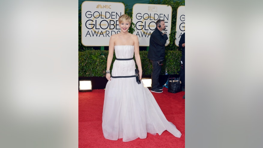 Jennifer Lawrence arrives at the 71st annual Golden Globe Awards at the Beverly Hilton Hotel on Sunday, Jan. 12, 2014, in Beverly Hills, Calif. (Photo by John Shearer/Invision/AP)