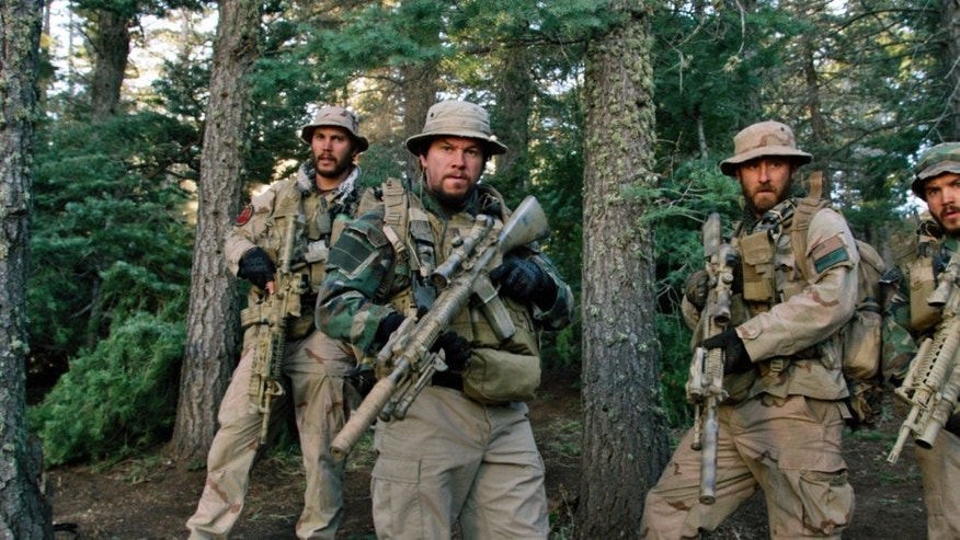"From left, Taylor Kitsch, as Michael Murphy, Mark Wahlberg as Marcus Luttrell, Ben Foster as Matt Axe Axelson, and Emile Hirsch as Danny Dietz in ""Lone Survivor."""