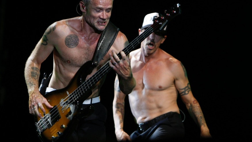"September 10, 2012. Red Hot Chili Peppers frontman Anthony Kiedis and bassist Michael ""Flea"" Balzary (L) perform during a concert at Hayarkon Park in Tel Aviv."