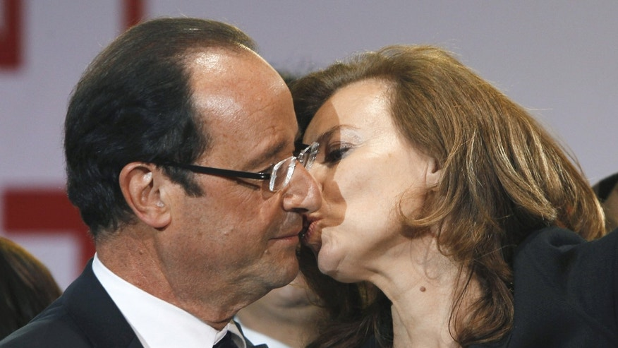 May 6, 2012. French president-elect Francois Hollande kissing his companion, Valerie Trierweiler, after greeting crowds gathered to celebrate his election victory in Bastille Square in Paris.