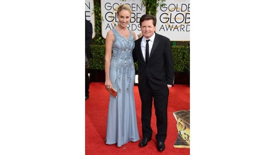 January 12, 2014: Tracy Pollan, left, and Michael J. Fox arrive at the 71st annual Golden Globe Awards at the Beverly Hilton Hotel in Beverly Hills, Calif. (Photo by Jordan Strauss/Invision/AP)
