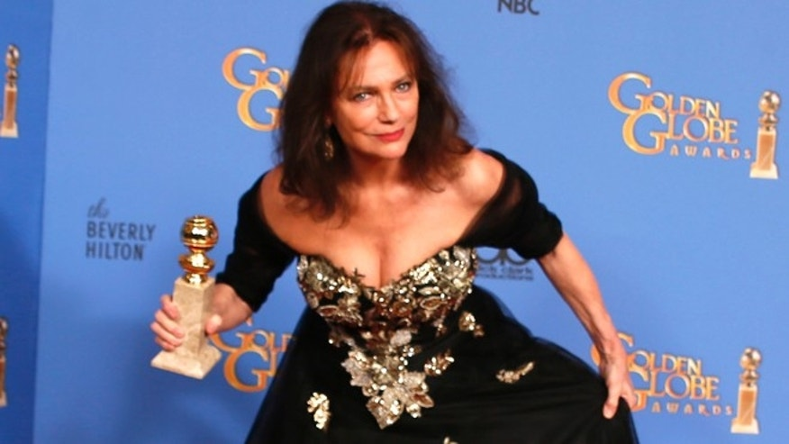 "Jacqueline Bisset poses backstage with her award for Best Supporting Actress in a Series, Mini-Series or TV Movie for her role in ""Dancing on the Edge"" at the 71st annual Golden Globe Awards in Beverly Hills, California January 12, 2014.   REUTERS/Lucy Nicholson (UNITED STATES  - Tags: ENTERTAINMENT)   - RTX17BI2"