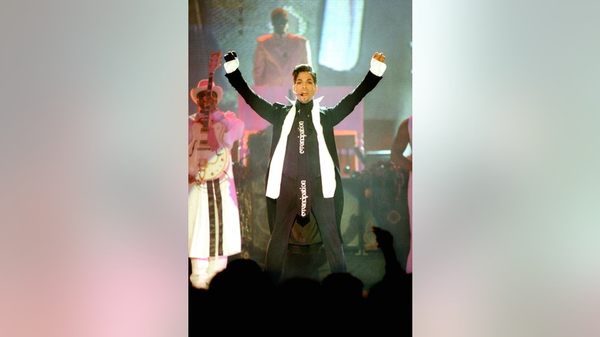 The artist formerly known as Prince performs at the Brit Awards, the UK's premier music awards at Earls Court in London February 24, 1997.   REUTERS/Kieran Doherty   (BRITAIN) - RTR1ED6D