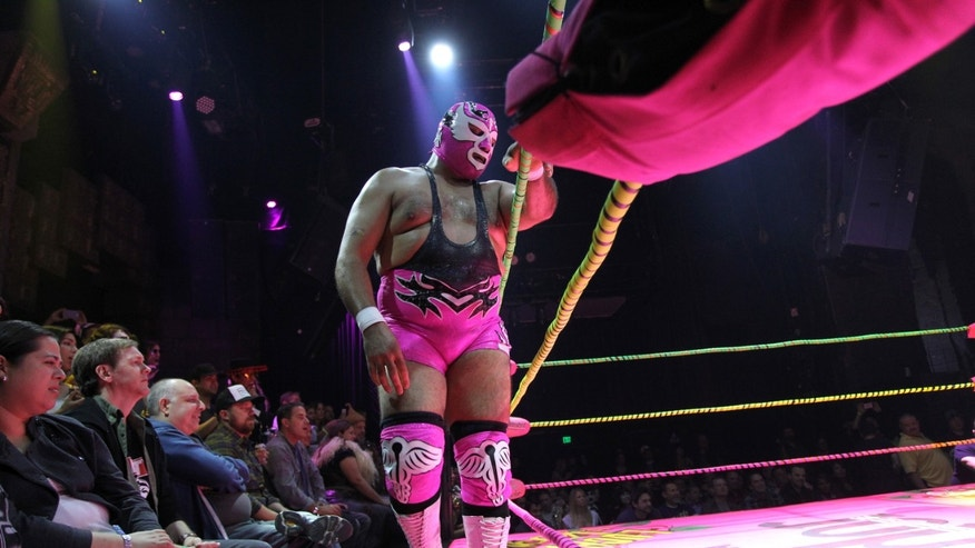 LOS ANGELES, CA - OCTOBER 30:  Luchadores perform at the Lucha Vavoom Noche de los Salvajes! Halloween show at the Mayan Theater on October 30, 2013 in Los Angeles, California. Lucha Vavoom mixes elements of theatrical good-versus-evil Mexican masked wrestling, known as Lucha Libre, with American burlesque and comedy, and attracts a cult following in southern California. (Photo by David McNew/Getty Images)