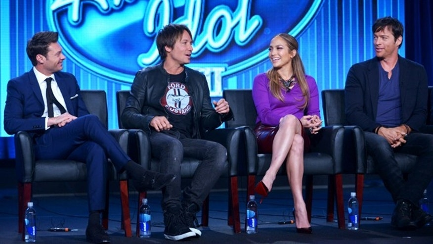 "From left, Host Ryan Seacrest, and Judges Keith Urban, Jennifer Lopez, and Harry Connick Jr. are seen during the panel of ""American Idol"" at the FOX Winter 2014 TCA, on Monday, Jan. 13, 2014, at the Langham Hotel in Pasadena, Calif. (Photo by Richard Shotwell/Invision/AP)"