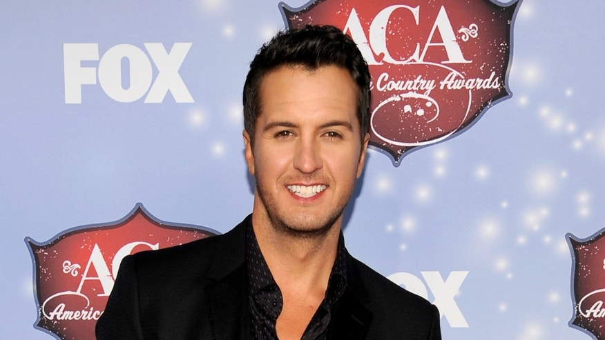 FILE - This Dec. 10, 2013 file photo shows Luke Bryan at the American Country Awards at the Mandalay Bay Resort & Casino in Las Vegas, Nev. Bryan announced the stadium shows in Pittsburgh in June and Philadelphia and Chicago in August during a news conference Tuesday, Jan 14, 2014. Bryan said he's stepping everything up as he heads into just his second headlining tour of about 80 dates. (Photo by Chris Pizzello/Invision/AP, File)