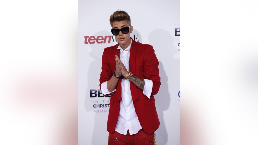 "December 18, 2013. Singer Justin Bieber poses at the premiere of the documentary ""Justin Bieber's Believe"" in Los Angeles, California."