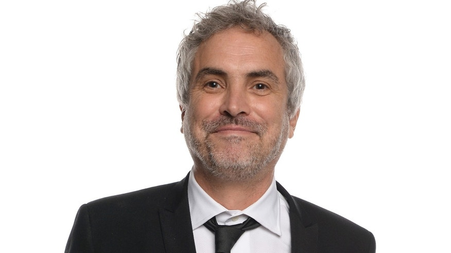 "Alfonso Cuarón, winner of Best Director for ""Gravity."""