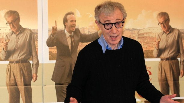 "U.S. director Woody Allen gestures during a photocall for the film"" To Rome with Love"" in Rome, April 13, 2012. REUTERS/Stefano Rellandini (ITALY - Tags: ENTERTAINMENT) - RTR30O6H"