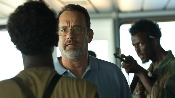 """This film image released by Sony - Columbia Pictures shows Tom Hanks, center, in a scene from """"Captain Phillips.""""   (AP Photo/Sony - Columbia Pictures)"""