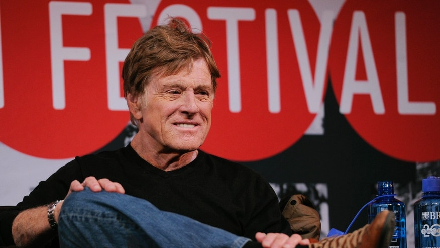 Robert Redford, founder and president of the Sundance Institute, looks on from the stage during the opening news conference of the 2014 Sundance Film Festival on Thursday, Jan. 16, 2014, in Park City, Utah.