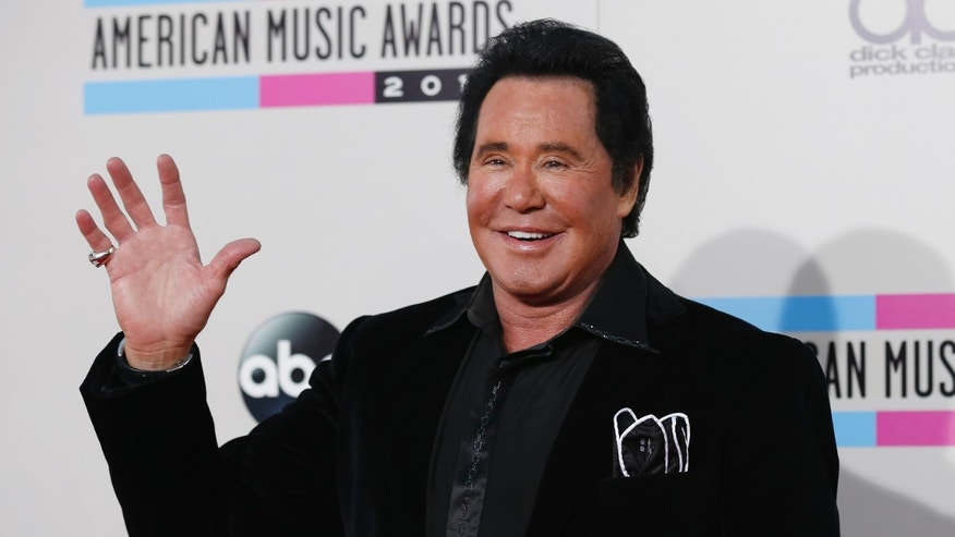November 24, 2013. Entertainer Wayne Newton arrives at the 41st American Music Awards in Los Angeles.