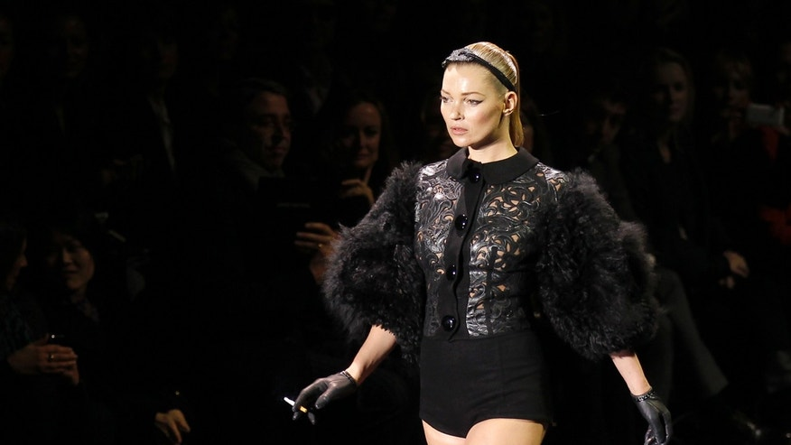 March 9, 2011. Kate Moss presents creation by U.S. designer Marc Jacobs as part of his Fall-Winter 2011/2012 women's ready-to-wear fashion collection for French fashion house Louis Vuitton during Paris Fashion Week.
