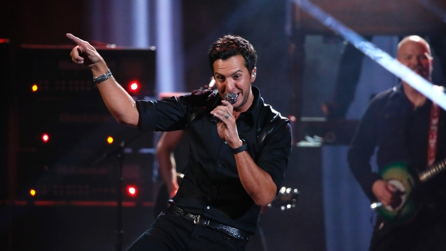 November 24, 2013. Luke Bryan performs at the 41st American Music Awards in Los Angeles.