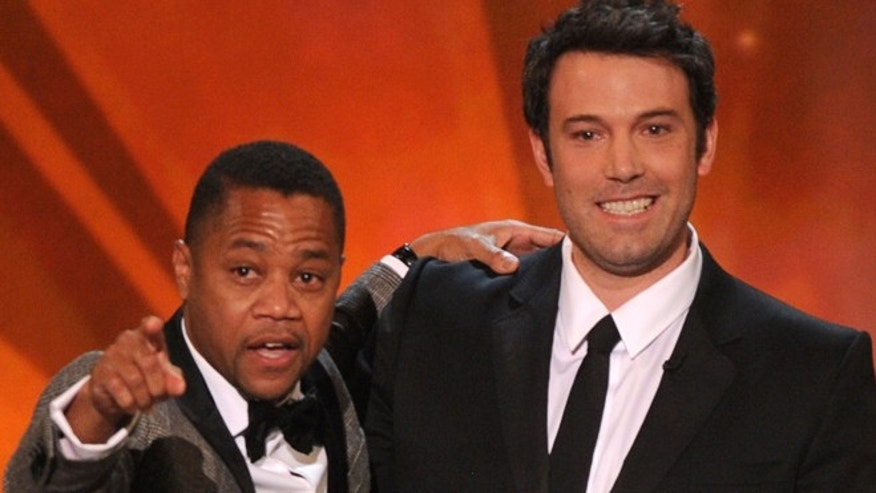 CORRECTS PERSON AT LEFT TO CUBA GOODING JR- Cuba Gooding, Jr, , left, and Ben Affleck speak on stage at the 20th annual Screen Actors Guild Awards at the Shrine Auditorium on Saturday, Jan. 18, 2014, in Los Angeles. (Photo by Frank Micelotta/Invision/AP)