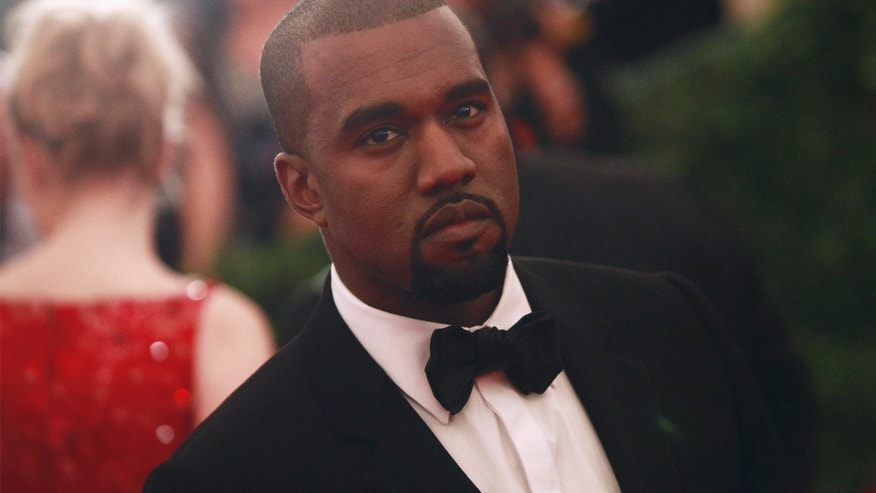 "Rapper Kanye West arrives at the Metropolitan Museum of Art Costume Institute Benefit celebrating the opening of ""Schiaparelli and Prada: Impossible Conversations"" exhibition in New York, May 7, 2012."